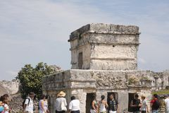 Side view of temple and tourists at Tulum, Mexico stock photos