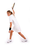Side view of tennis player ready to hit the ball Stock Image