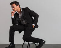 Side view of a thoughtful elegant man sitting on chair Royalty Free Stock Photo