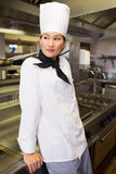 Side view of thoughtful female cook in kitchen Stock Photography