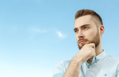 Side view of thoughtful young man Stock Images