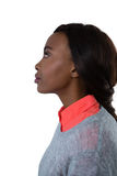 Side view of thoughtful young woman looking up. Against white background Stock Photo