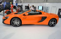 Side view to McLaren650S luxury orange sport car. Royalty Free Stock Photography
