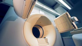 Tomographic machine`s elements moving. An empty MRI CT PET scanner. Side view of tomographic machine`s elements coming into place. 4K stock footage