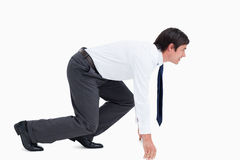 Side view of tradesman in sprinting position Stock Photo