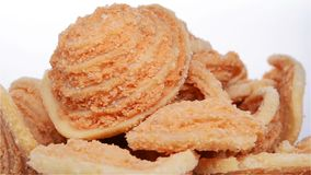 Traditional Chinese snack of deep fried biscuits rotating. Side view traditional Chinese snack of deep fried biscuits rotating stock video footage