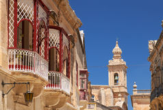 A side view of traditional Maltese style balconies in Mdina. Mal Royalty Free Stock Photography