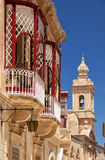 A side view of traditional Maltese style balconies in Mdina. Mal. A view of old Mdina street with a traditional Maltese style openwork balconies and Carmelite Royalty Free Stock Images
