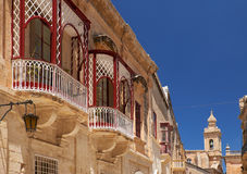 A side view of traditional Maltese style balconies in Mdina. Mal Stock Images