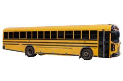 Traditional school bus, isolated on white background. Side view of a traditional school bus, isolated on white background Stock Images