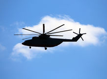 Side view of transport helicopter in flight Stock Image