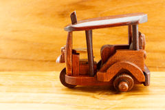 Side view Tuk Tuk wood toy Royalty Free Stock Photos