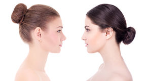 Side view of two beautiful women with perfect skin  on w Stock Photos