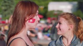 Side view of two football female fans in fan zone. In Moscow stock video