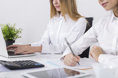 Side view of two girls working in an office Stock Photo