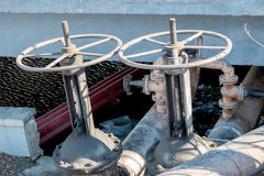 Side view of two industrial valves outdoors Royalty Free Stock Photography