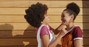 Two mixed race women hugging