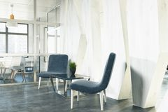 Office waiting area, blue armchairs, side Stock Image