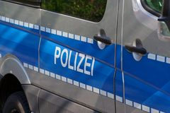 Side view of a typical German police car - `Polizei`. Side view of a typical German police car with lettering `Polizei` on blue background. Hamburg, Germany stock images