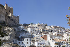 Side view of the village, on top of limestone mountain is situated Castle of the 12TH century Almohad origin, take in Alcala of t. Alcala del Jucar, Spain stock photo