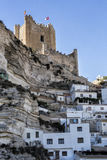 Side view of the village, on top of limestone mountain is situated Castle of the 12TH century Almohad origin, take in Alcala of t. Alcala del Jucar, Spain royalty free stock photography