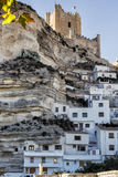 Side view of the village, on top of limestone mountain is situated Castle of the 12TH century Almohad origin, take in Alcala of t. Alcala del Jucar, Spain stock image