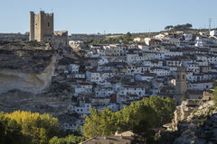 Side view of the village, on top of limestone mountain is situated Castle of the 12TH century Almohad origin, take in Alcala of t. Alcala del Jucar, Spain royalty free stock images