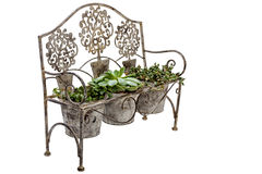 Side View of Vintage Ornate Rusted Wrought  Iron bench Stock Images