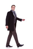 Side view of a walking business man Royalty Free Stock Photo