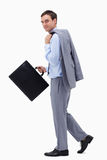 Side view of walking businessman with suitcase Royalty Free Stock Photo