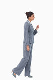 Side view of walking businesswoman Royalty Free Stock Photo