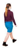 Side view of walking  woman in dress. beautiful girl in motion. Stock Photo