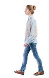 Side view of walking  woman in vest Royalty Free Stock Photo