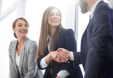 Side view.welcome and handshake of business people. Close up stock images