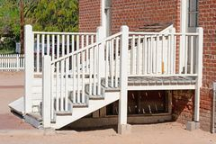 White stairs leading to the entrance of a brick building royalty free stock photography
