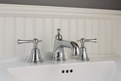 Side view of white sink. Side view of classic style bathroom interior with white sink and faucet Royalty Free Stock Photography