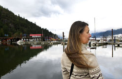 Side View of a Wholesome Middle-aged Woman in Marina. Wholesome Middle-aged Woman Waiting for the Ferry at Horseshoe Bay, BC Dock with View of a Local Fishing Royalty Free Stock Photo