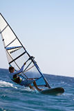 Side view of a windsurfer mooving horizontally Stock Photography
