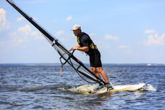 Side  view of windsurfer Stock Photo