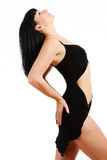 Side view of the woman arching. Royalty Free Stock Photography