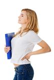 Side view of woman with back pain holding a binder Stock Image
