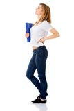 Side view of woman with back pain holding a binder Royalty Free Stock Image