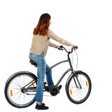 Side view of a woman with a bicycle. Stock Photography