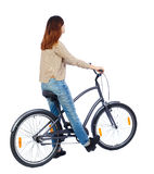 Side view of a woman with a bicycle. Royalty Free Stock Image