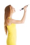 Side view of a woman with big crayon writing Royalty Free Stock Photography
