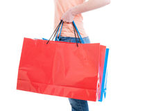 Side view of woman carrying big shopping bags Royalty Free Stock Photos