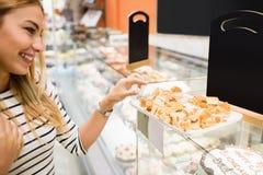 Side view of woman choosing dessert Stock Image