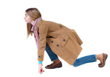 Side view woman in cloak start position. Stock Image