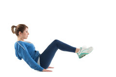 Side view of woman in core balance pilates pose. Full length side view of woman in core balance pilates pose over white background Stock Images