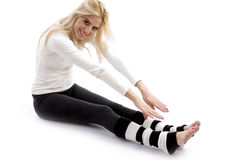 Side view of woman doing stretching exercise Royalty Free Stock Photos